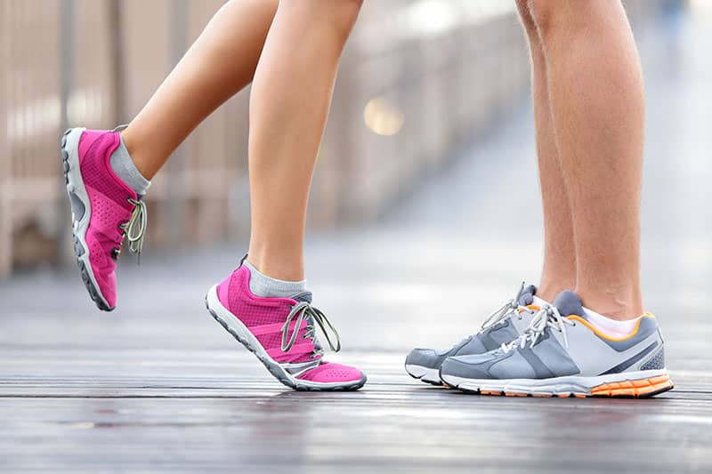 Love sport concept – running couple kissing